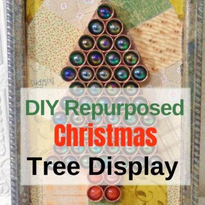 DIY Christmas Tree display created from repurposed marbles and copper plumbing caps