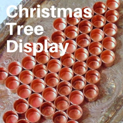 DIY Christmas Tree from repurposed items displayed on a silver tray