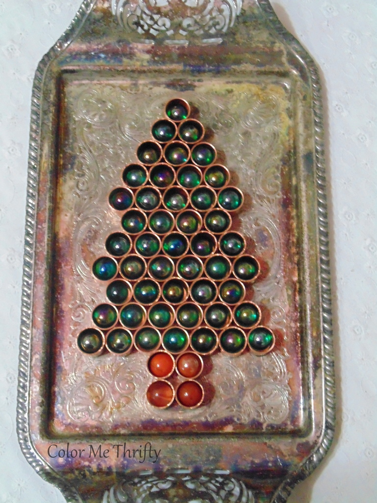 DIY Christmas tree aftter copper caps filled with colored marbles