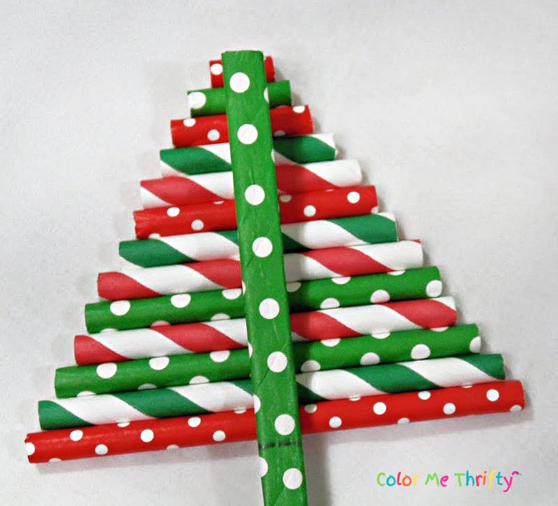Hot gluing flattened paper straw onto back of tree shaped straws