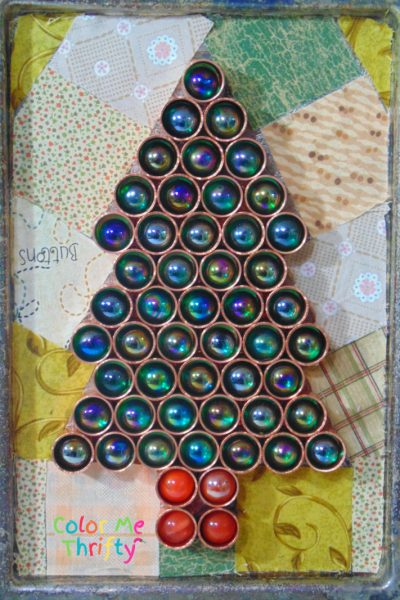 Repurposed copper caps and marbles into Christmas tree on silver tray