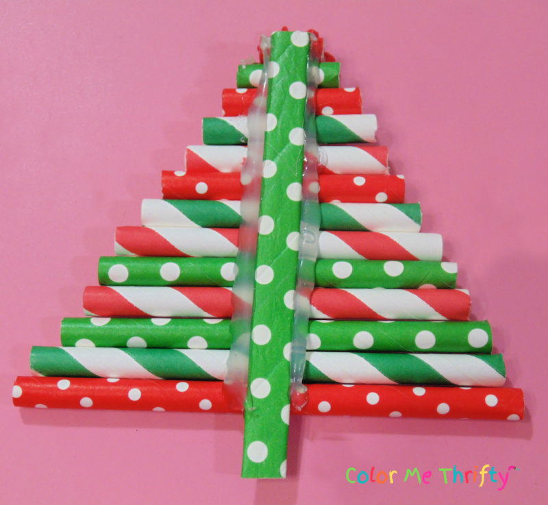 adding glue to sides of paper straw tree ornament stem for extra stability