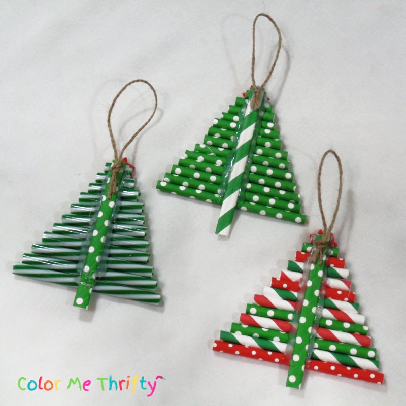 gluing jute twine hangers onto back of repurposed straw Christmas tree ornaments