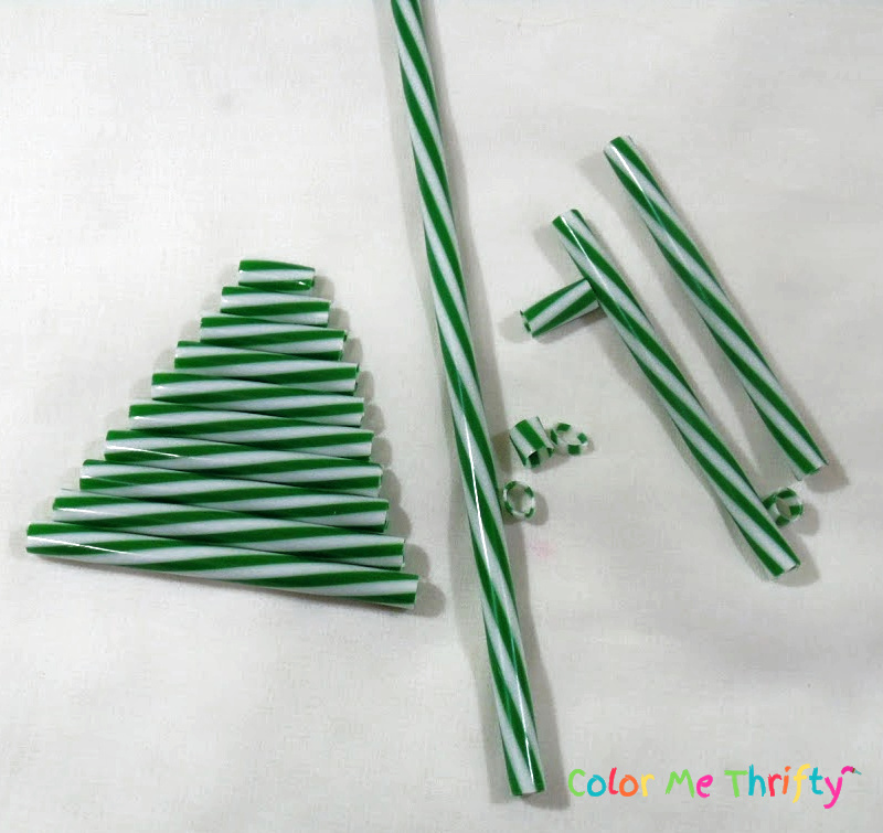 plastic green and white straw cut into Christmas tree shape