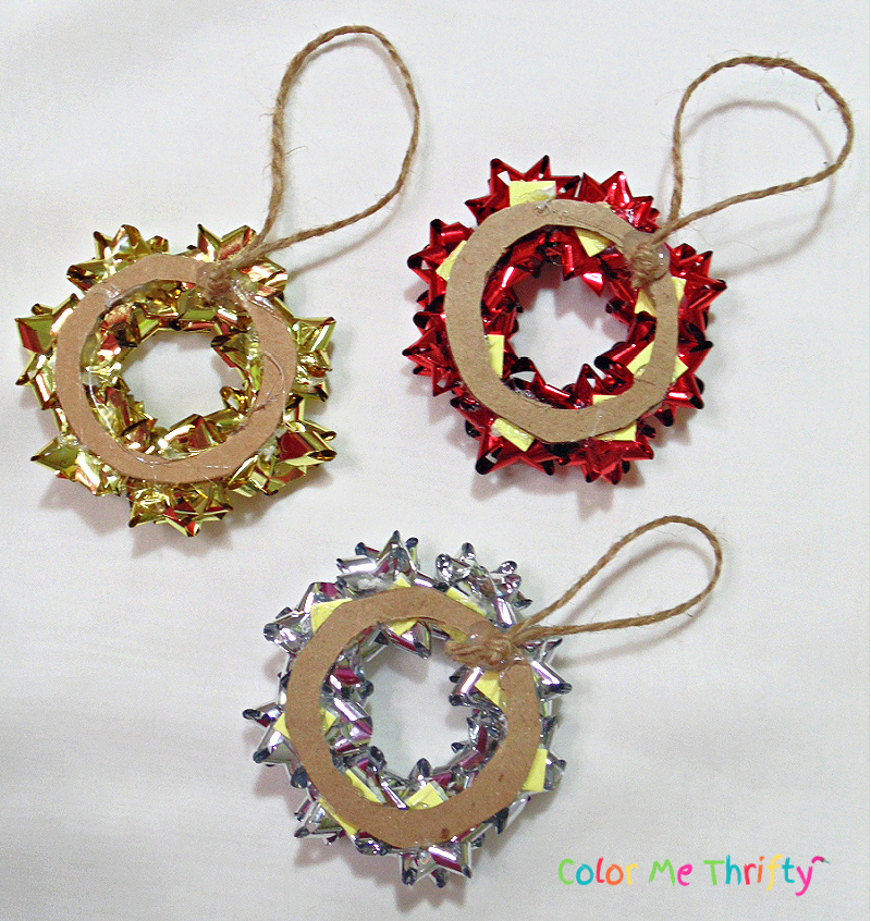 jute twine glued onto backs of wreath ornaments made from repurposed mini gift bows