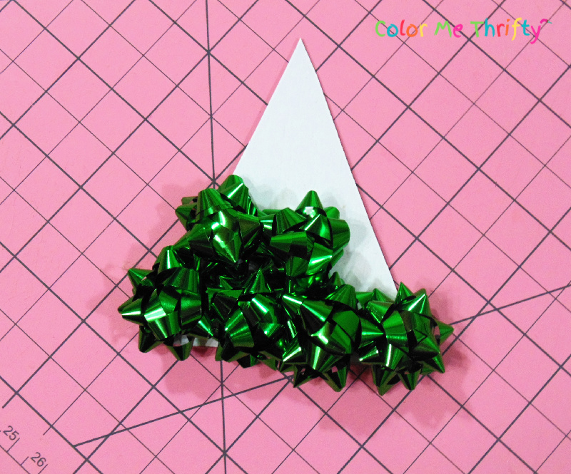using cardboard cutout for frame of mini gift bow tree ornament
