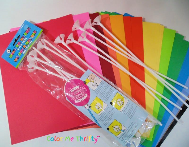 cardstock paper in various colors and balloon sticks