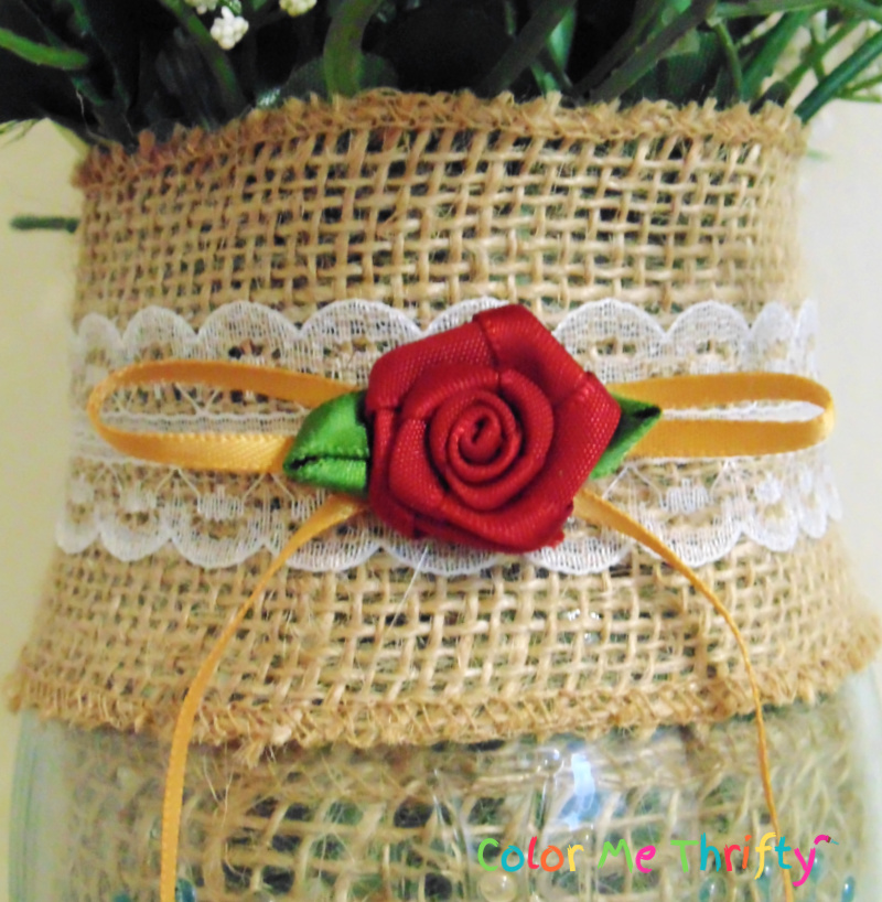 close up of burlap and lace ribbon trim and millinery flowers decoration