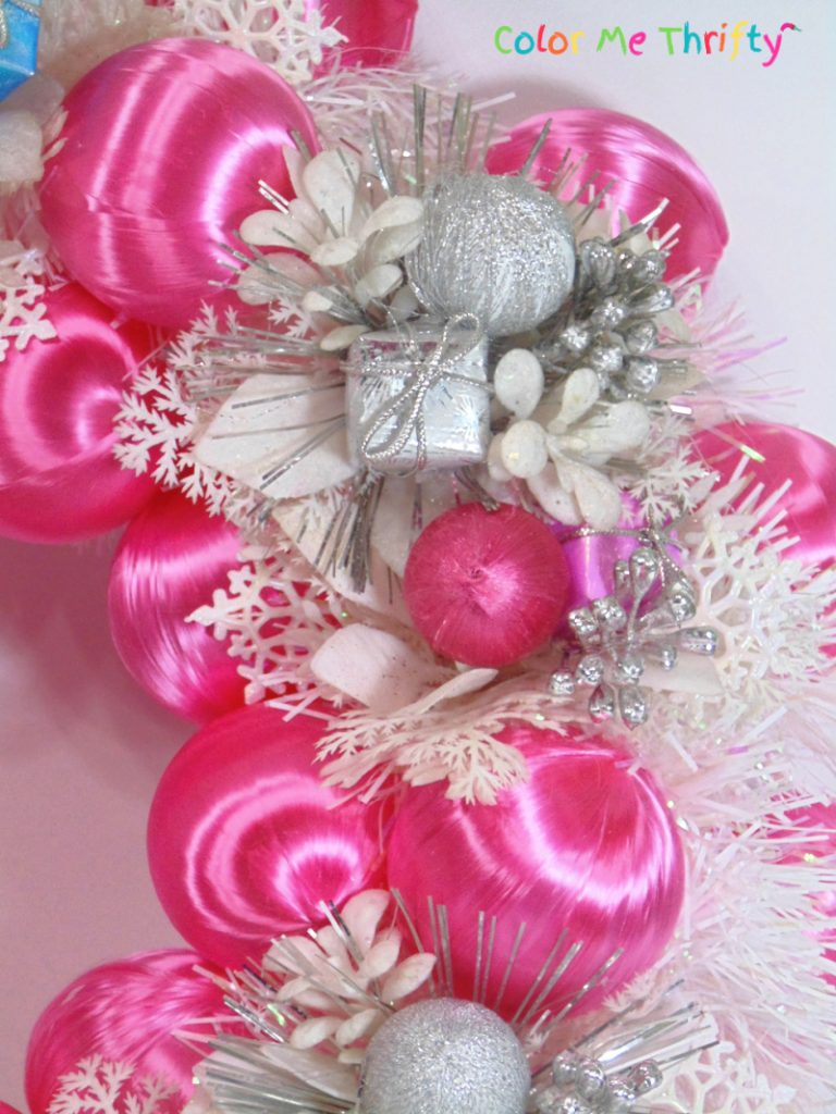 pink winter wreath with satin ball ornaments and flower picks