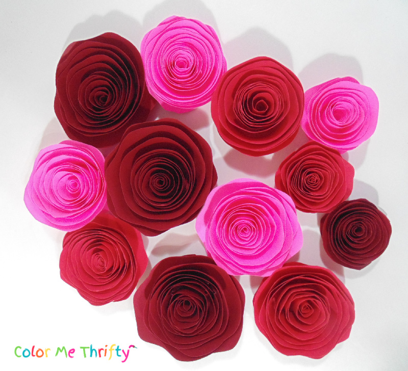 red, burgundy, and pink diy rolled paper roses 1