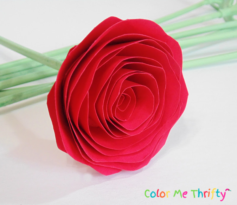 red paper rose after balloon stick stem glued on