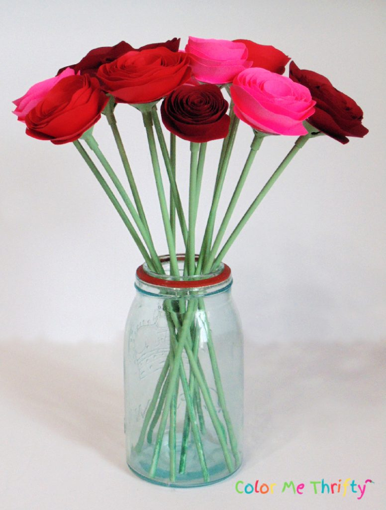 rolled paper flowers in mason jar vase
