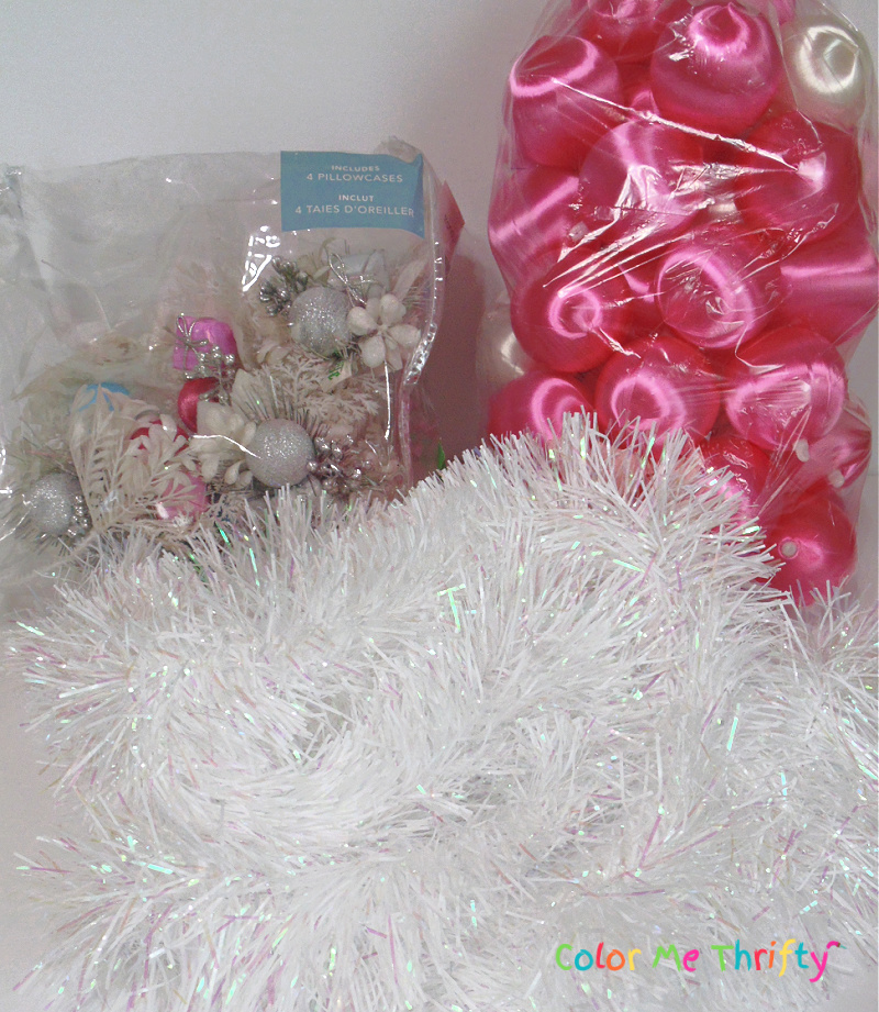 white garland, pink satin ball ornaments, and winter flower picks for pink winter wreath