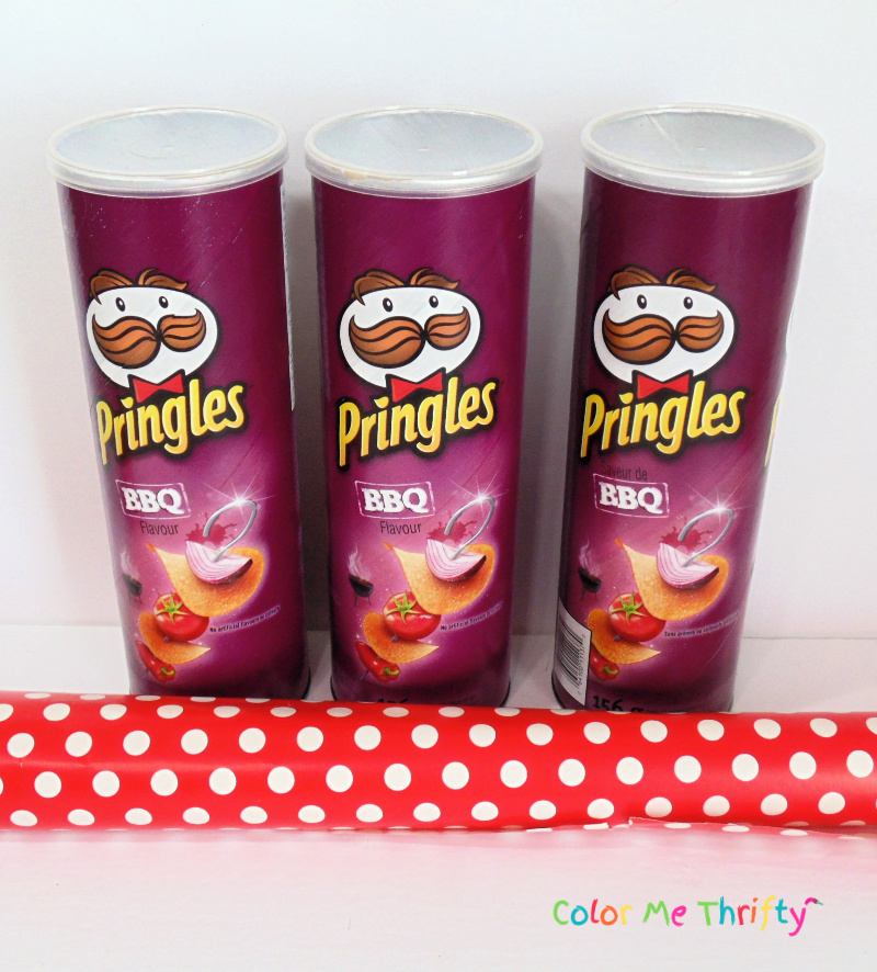 3 pringles cans and red polka dot wrapping paper