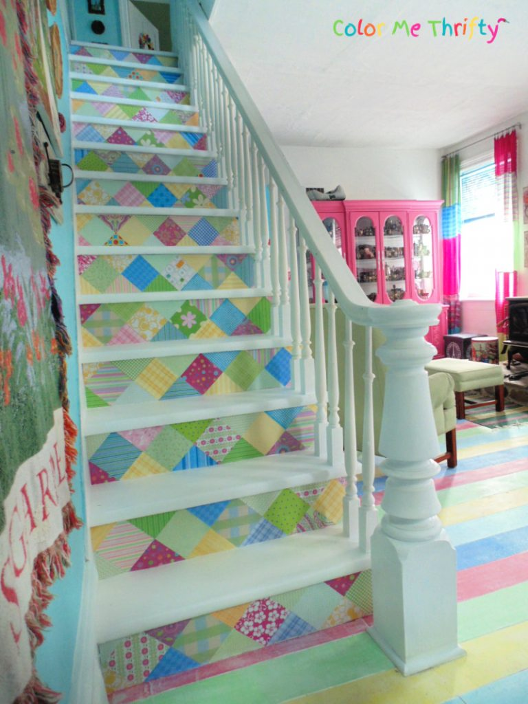 Decoupaged scrapbook paper stairs makeover