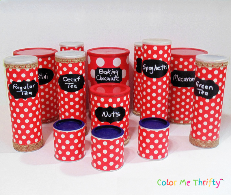 Group picture of Pringles cans, hot cholocate cans, tea cans, all decoupaged with wrapping paper