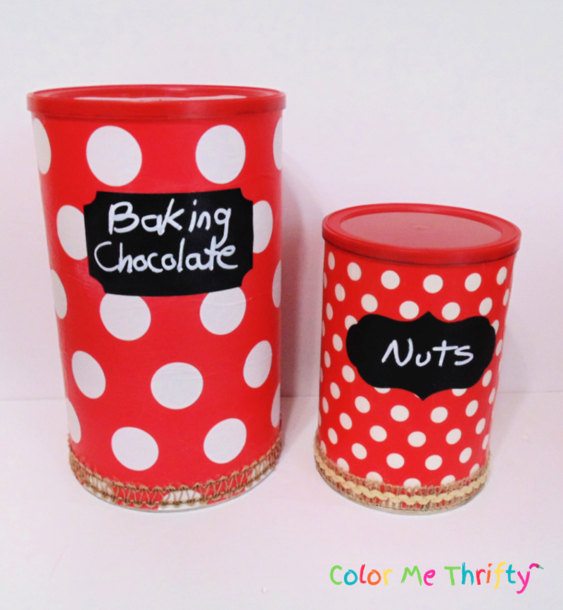 Large and small hot chocolate cans decoupaged with wrapping paper