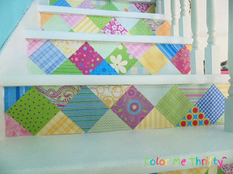 applying scrapbook paper contact paper to stair riser