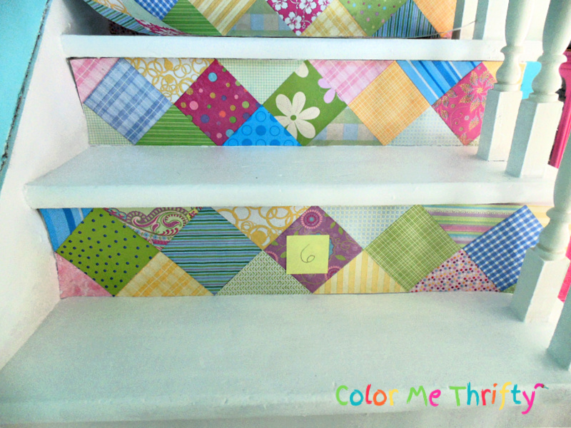 doing a dry fit of scrapbook paper on stairs