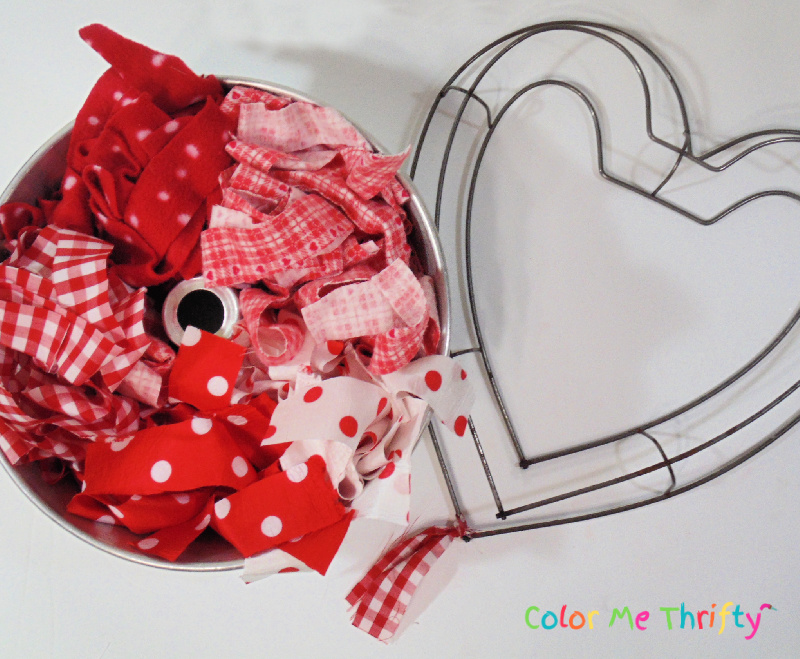 gathering up my fabric strips to begin creating DIY rag heart wreath
