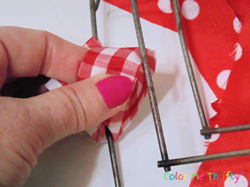 looping fabric through to attach it to wire heart wreath frame