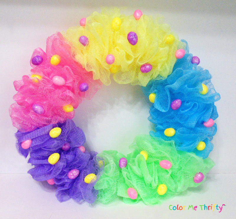 adding small Easter eggs onto shower poufs to create easy Easter wreath