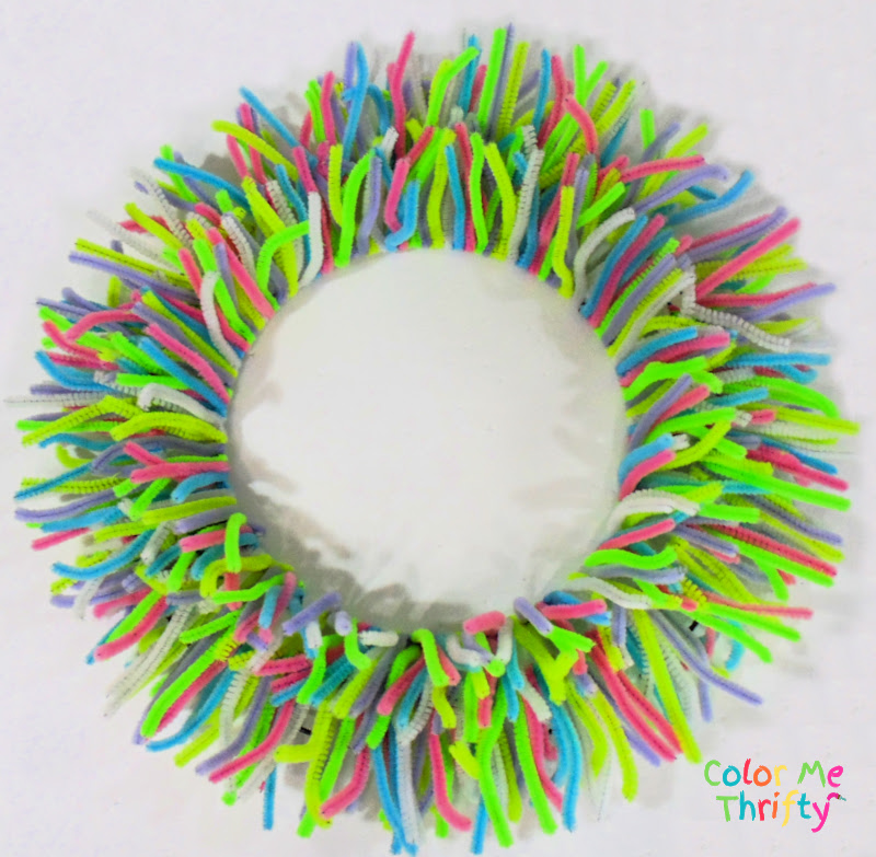 pipe cleaners wrapped around metal wreath frame with two sections done