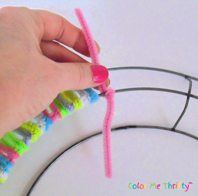 wrapping pipe cleaners around metal wreath frame