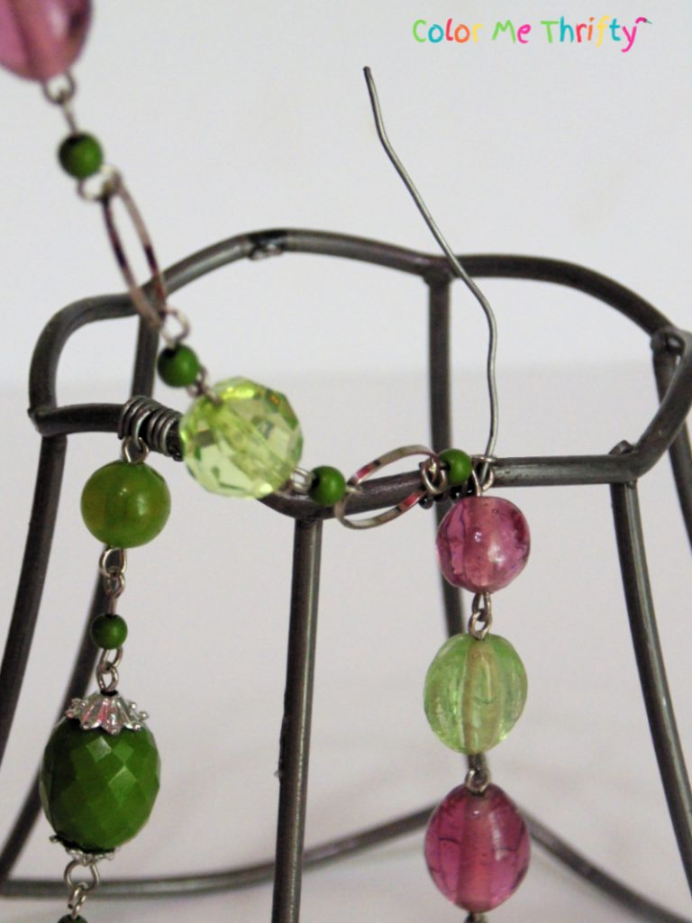 attaching both top and bottom necklace sections with wire onto lampshade frame