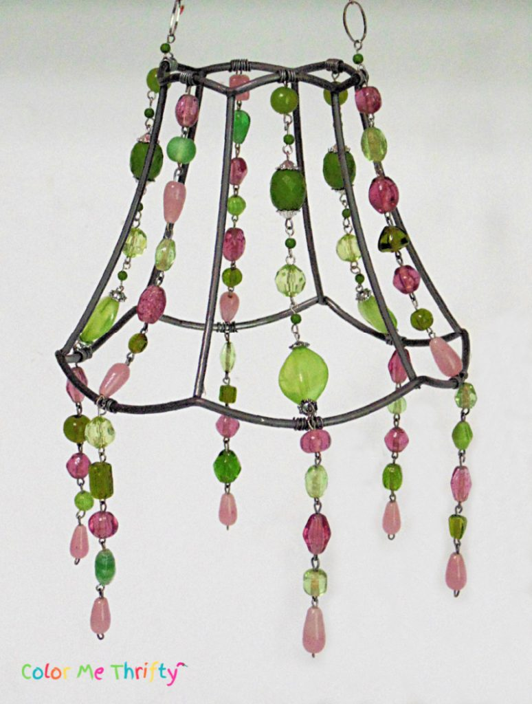 hanging necklace sections attached to lampshade frame