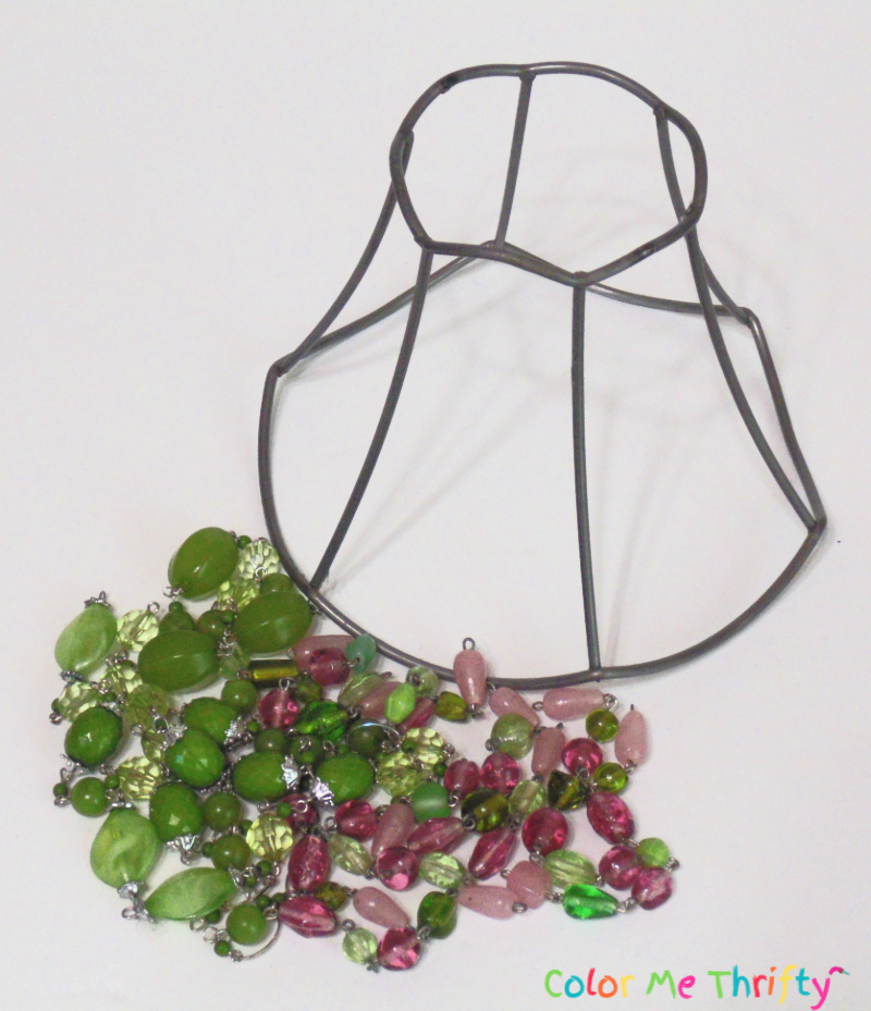 metal lampshade frame and thrifted necklaces for repurposed lampshade wind chime