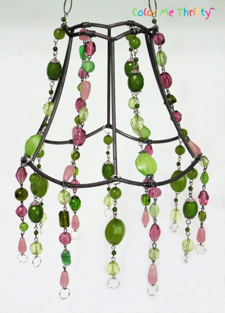 metal repurposed lampshade wind chime with necklace sections for decorations and for hanging