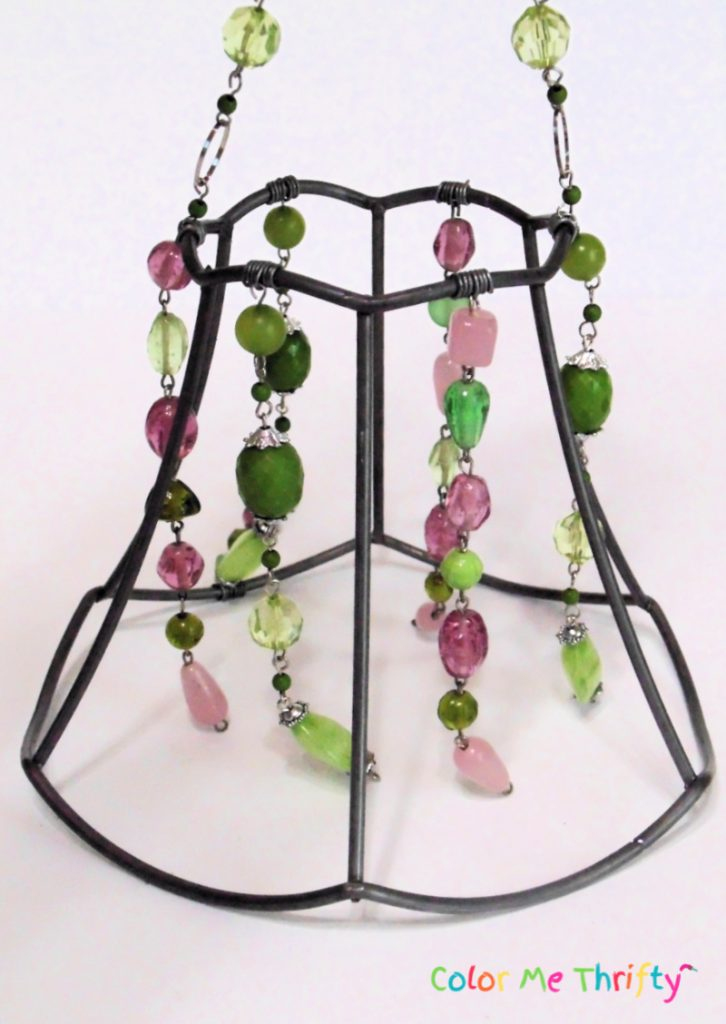 necklaces sections attached within the lampshade frame sections