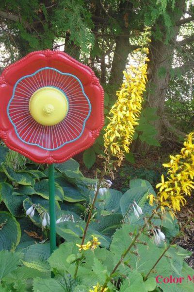 spray painted garden junk flower in garden