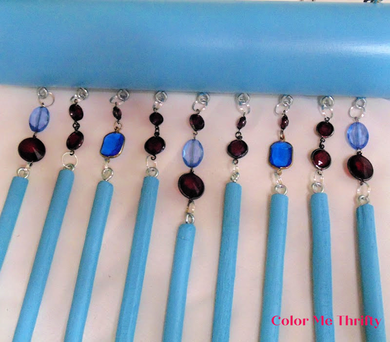 attaching wooden spoons onto necklace pieces using split rings