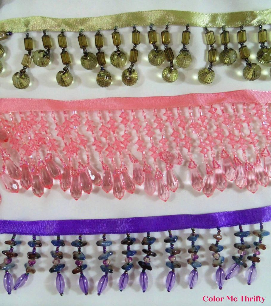 green, pink, and purple beaded ribbons
