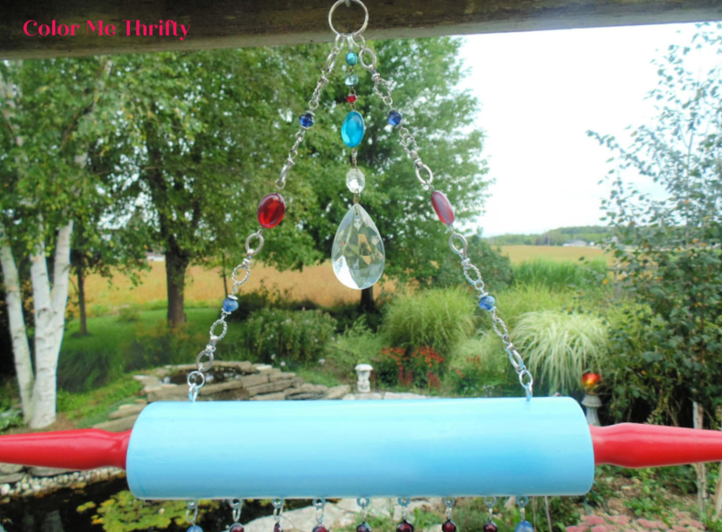 Spray painted wooden rolling pin wind chime with necklace parts and wooden spoons