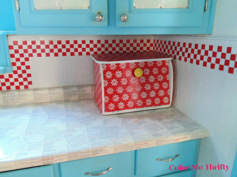 Wooden bread box makeover using lace as a stencil and spray paint