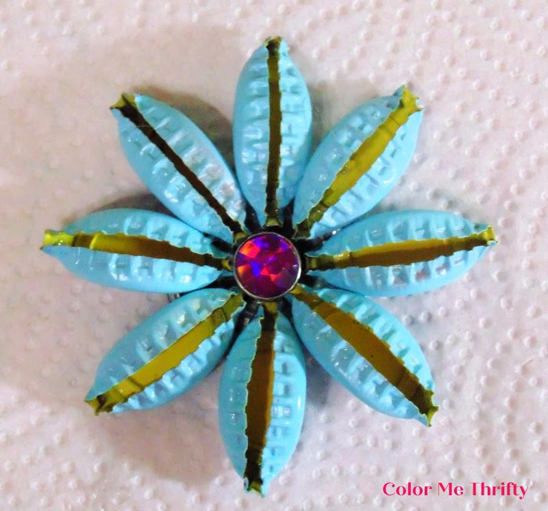 blue spray painted repurposed beer cap flowers