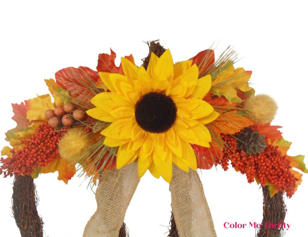close up of fall foliage added to grapevine pumpkin fall wreath