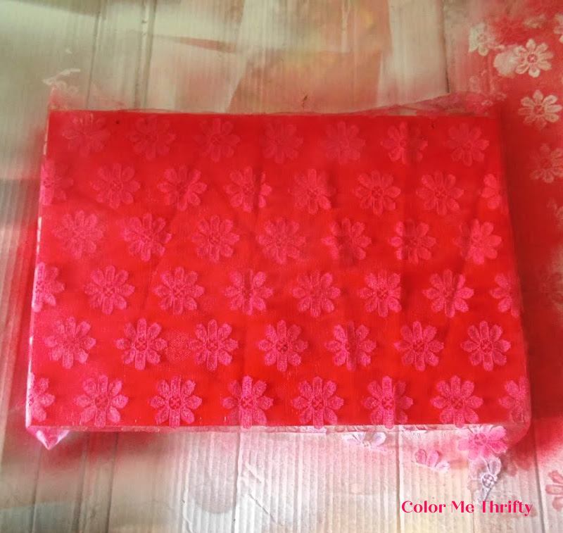 floral lace used as a stencil for bread box makeover