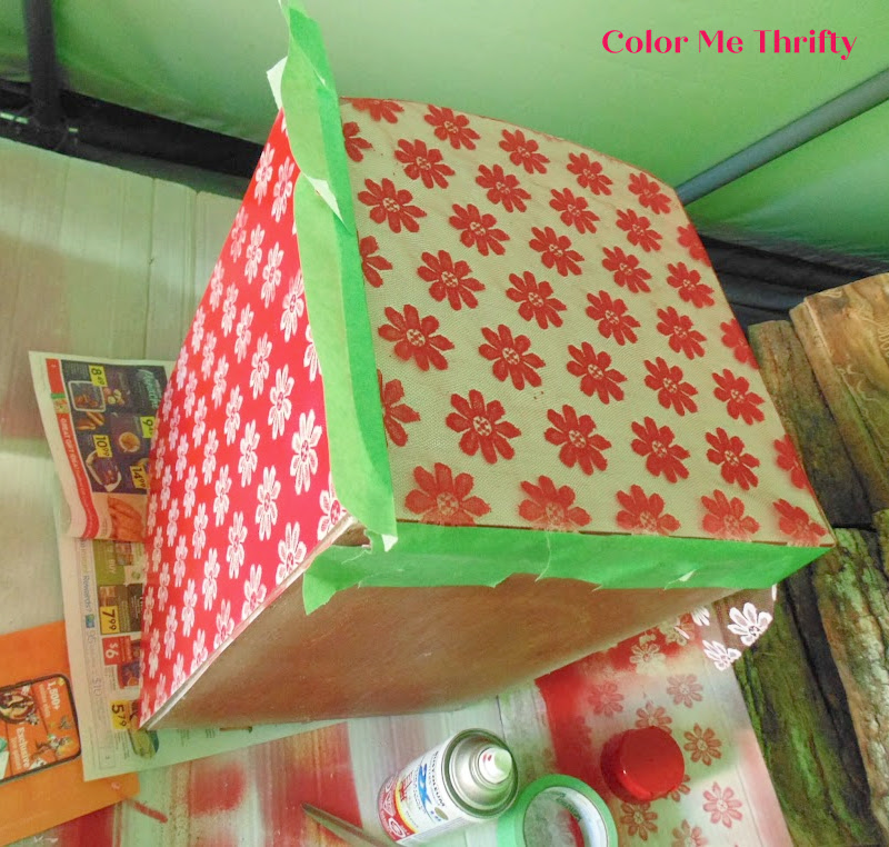 lining up floral lace on side of bread box to match up with the top