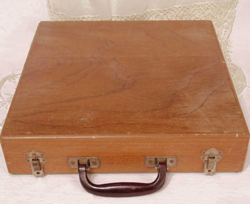 Wooden box that holds Vintage 29 piece Siam Cutlery Set