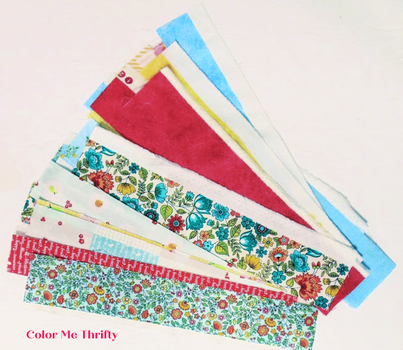 variety of red and blue fabric selvages
