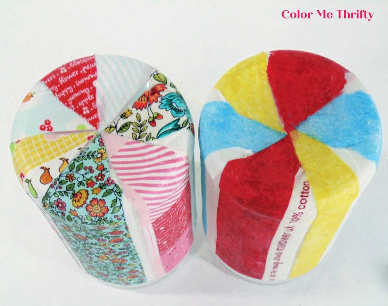 view of bottom of decoupaged peanut butter jars